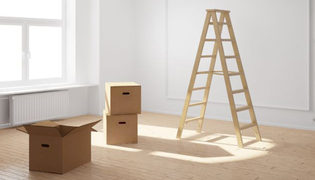 20588309 - empty room with ladder and cardboard boxes and hardwood floor